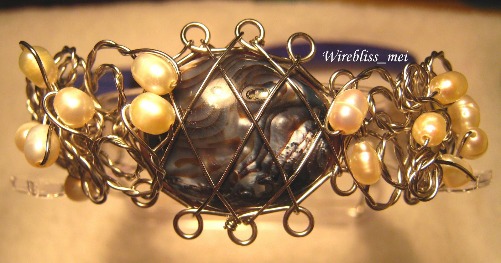 Wire wrapped Shell Brangle