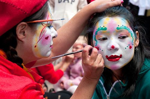 clown faces makeup. A make-up artist uses a girl#39;s