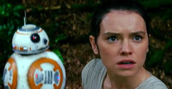 With BB-8 in the background, Rey (Daisy Ridley) looks concerned in STAR WARS: THE FORCE AWAKENS.
