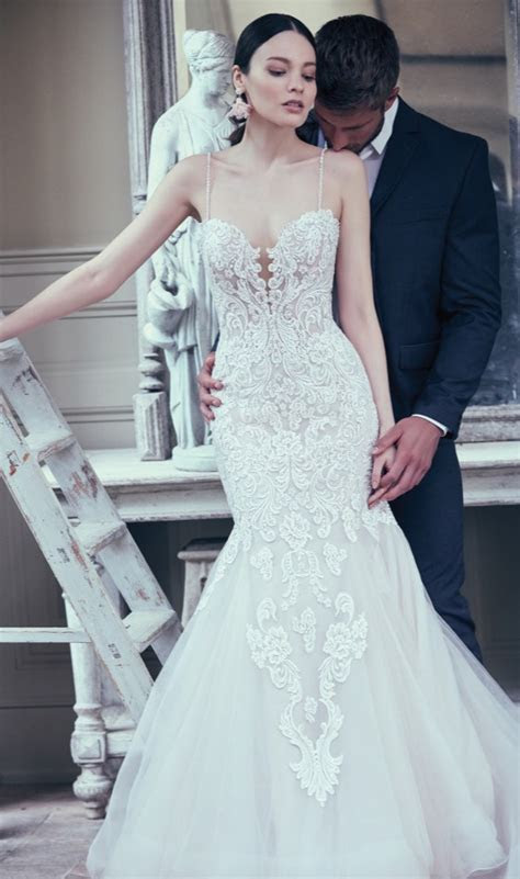 This glamorous fit and flare wedding gown features a