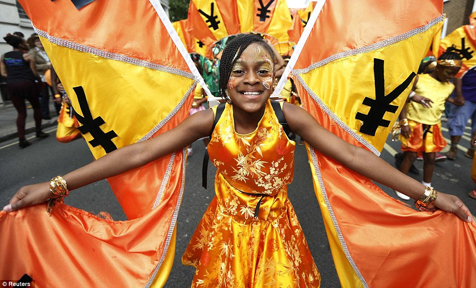 All smiles: A performer dances in the street during the children's day parade