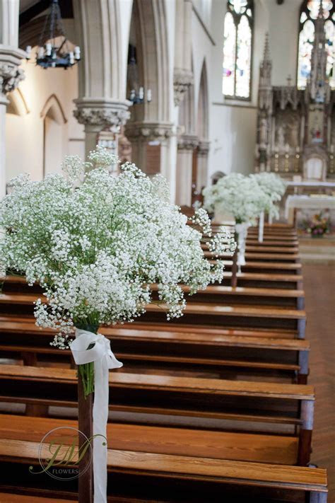 Flower stands decorated with gypsophila. Church wedding