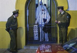 Police leave the residence of Mohammed Saif Ur Rehman Khan in downtown Santiago, late Monday, May 10, 2010.