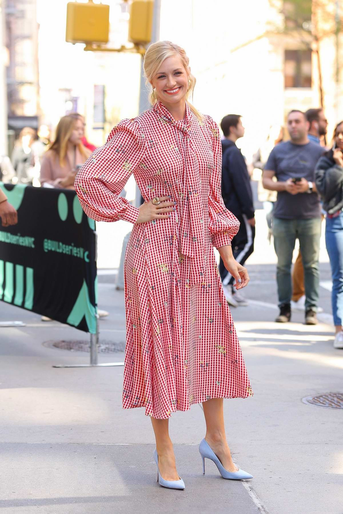 Beth Behrs looks pretty in a pink spring dress as she visits AOL