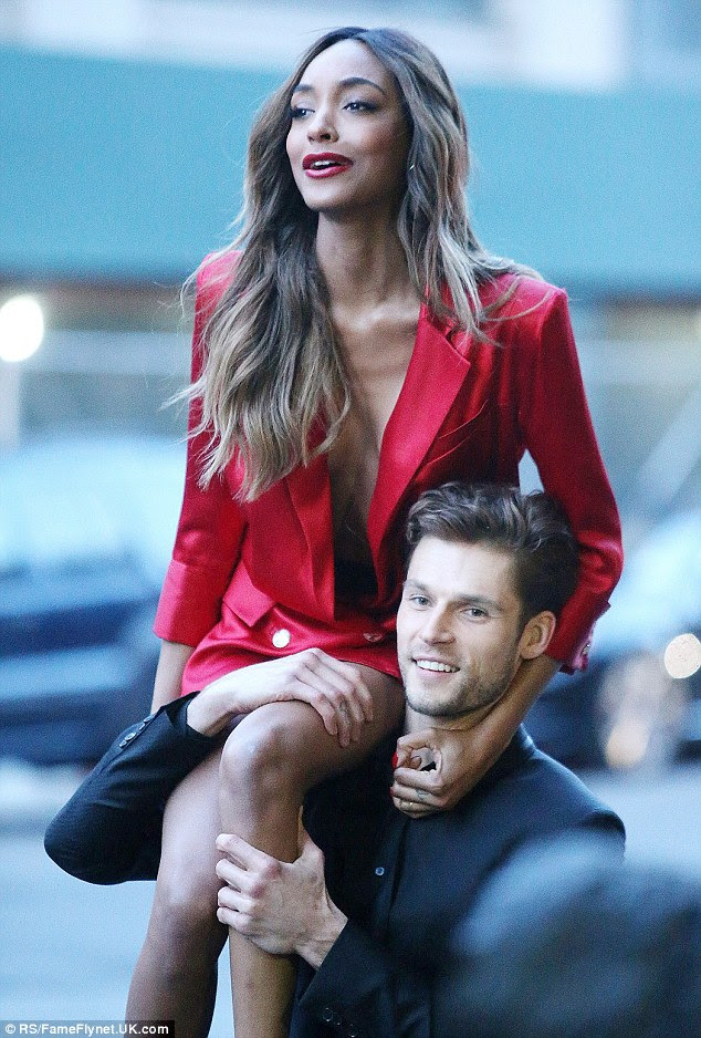 Careful!After sporting the bold look, she later flashed her incredible legs and humble cleavage in a slinky red tuxedo dress which emphasised her slim figure