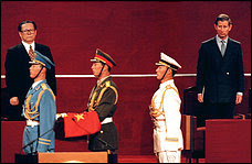 A visibly irritated Prince Charles, right, stands by as the Chinese flag is brought in to replace the Union Jack at the 1997 ceremony transferring control of Hong Kong. Charles later wrote: