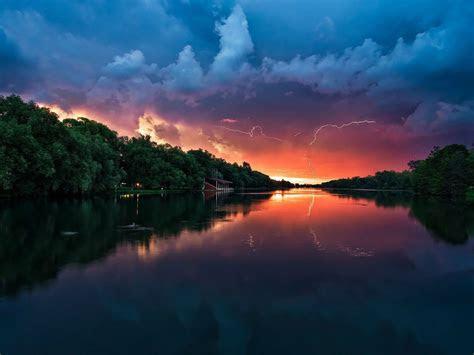 sunset peaceful river coast  green trees forest red sky lightning  wallpaperscom
