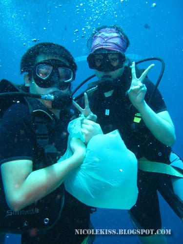picking up trash underwater