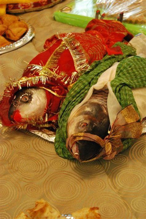 Bengali Wedding with Fish dressed as bride and groom
