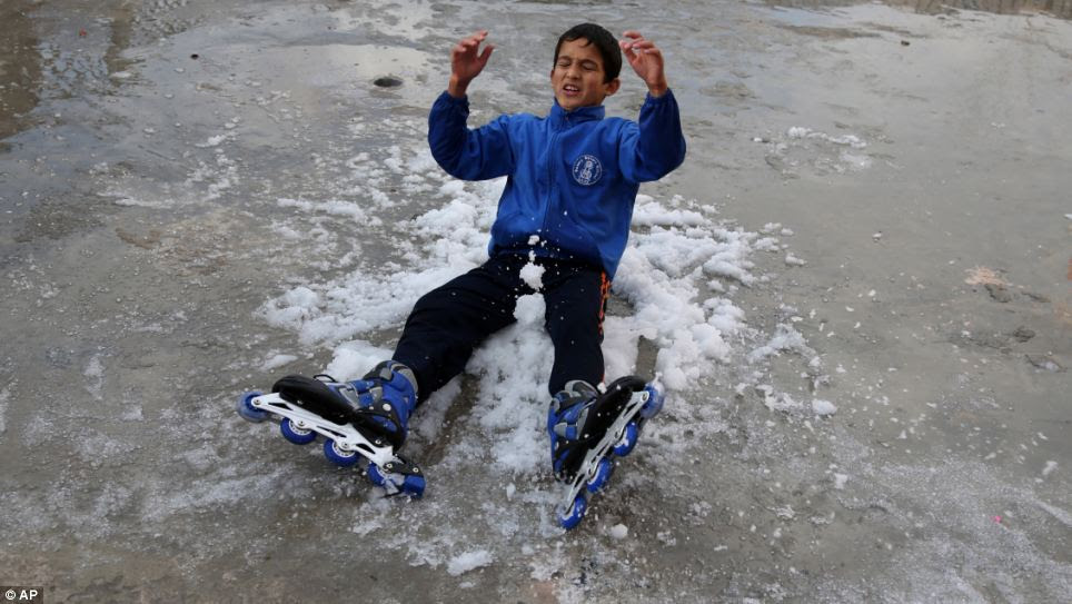 Playtime: A Palestinian child plays in the snow brought by the unusually severe blizzard, dubbed Alexa