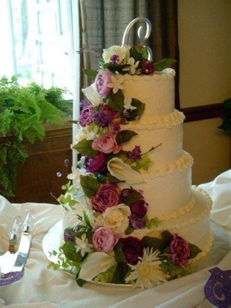 Silk flowers on wedding cake   wedding ideas  for
