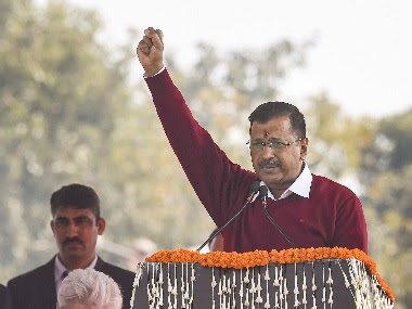 AAP chief Arvind Kejriwal raises slogans during his speech after he was sworn-in as the Chief Minister of Delhi for the third time. PTI