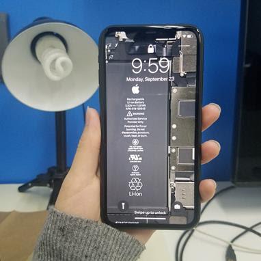 iPhone 11 with teardown wallpaper on its lock screen