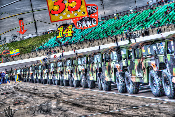 The drivers rode around in the back of these Hummers after driver announcements.2013 STP4000065_6_7_tonemapped