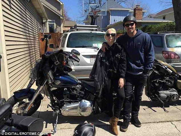 Hitting the road: Cosying up to the Chicago Fire star before they set off, Gaga looked thrilled to be spending some quality time with her man