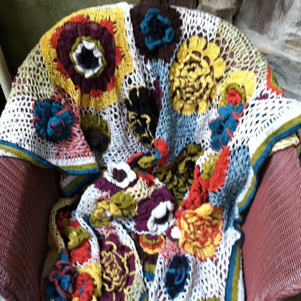 A crochet blanket from anthropologie thatbi gotta make too!!!