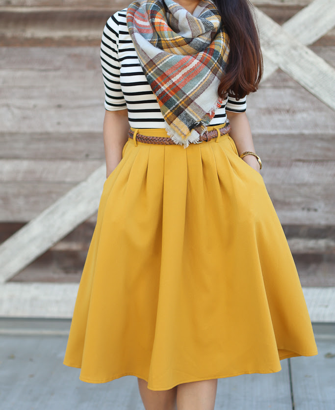 mustard pleated skirt striped shirt plaid blanket scarf