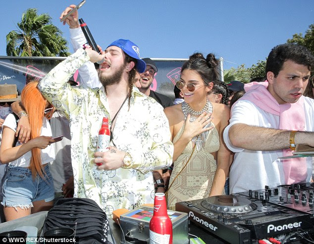 Fun times: Her younger sister Kylie (L) lurked in the background as Jenner grooved to the tunes DJ Daniel Chetrit (R) spun at the private estate
