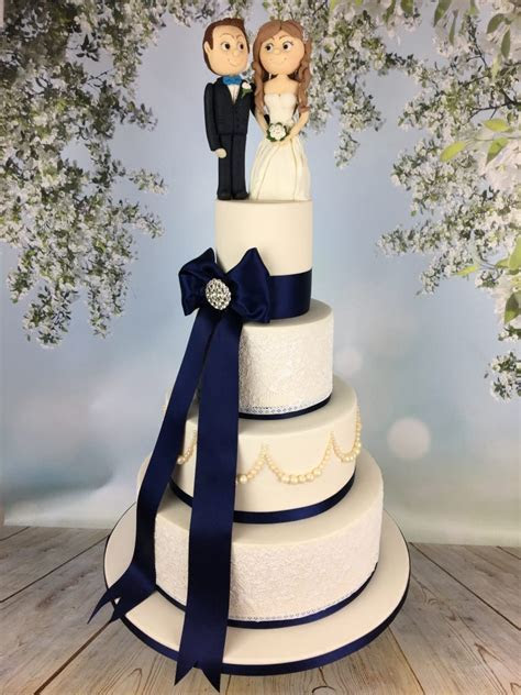 Navy bow and Ivory lace wedding cake   Mel's Amazing Cakes