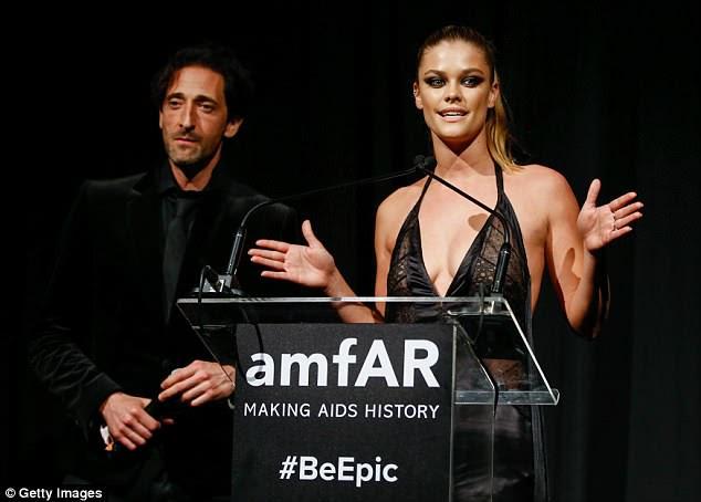 Speaking out: Nina Agdal se juntou a Adrien no palco durante a gala