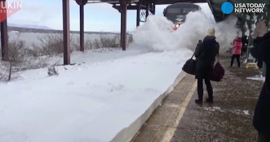 Video shows Amtrak train blasting commuters with mounds of snow
