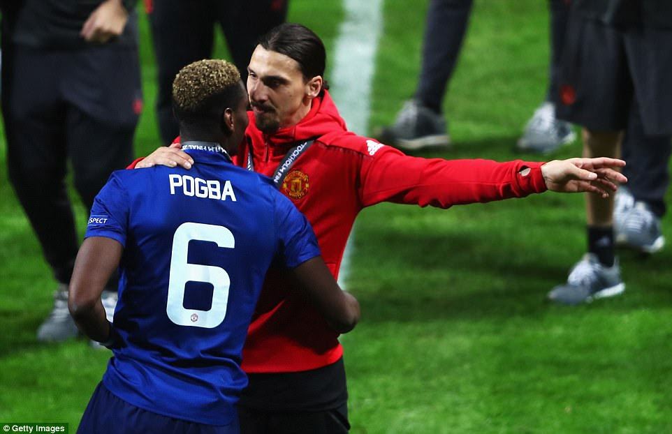 Zlatan Ibrahimovic, who missed the final due to a knee injury, speaks to Pogba following the full-time whistle on Wednesday