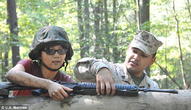 Marine gunman: Sgt. Eusebio Lopez, seen right during a training exercise, has been identified as the 25-year-old tactics instructor that took the lives of two fellow Marines on Thursday night