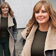 Counting down to the cold: Carol Vorderman ditches tight dresses for her favourite winter-proof coat