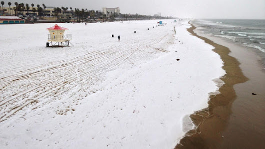 Hail coats beach as storm brings lightning, flood warnings