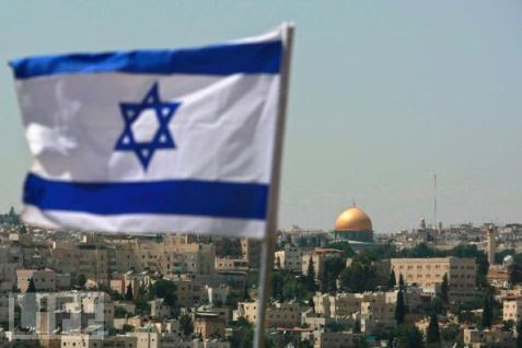 The Flag of Israel with the Temple Mount in the distance