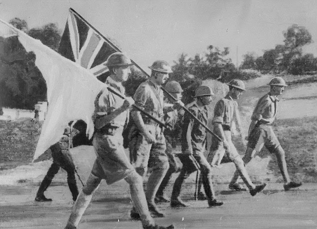 Lieut-General A.E. Percival, Commanding chief of the last garrison of Singapore is on his way to sign the deed of its surrender in 1942
