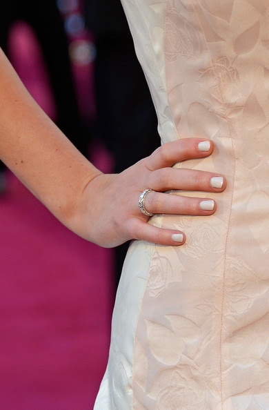 Actress Jennifer Lawrence (jewelry detail) arrives at the Oscars at Hollywood & Highland Center on February 24, 2013 in Hollywood, California.