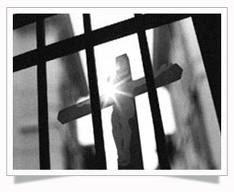 Cross through prison bars