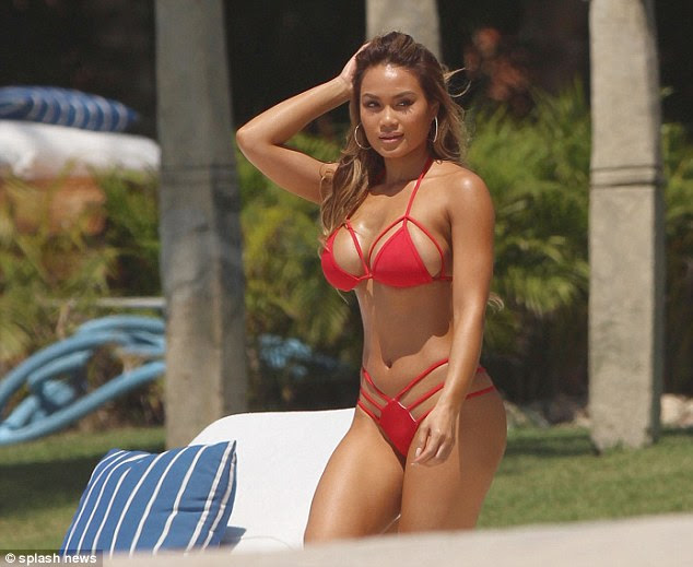 She's got some front! The Instagram model put her ample assets on display in a barely-there bikini top with cut-outs