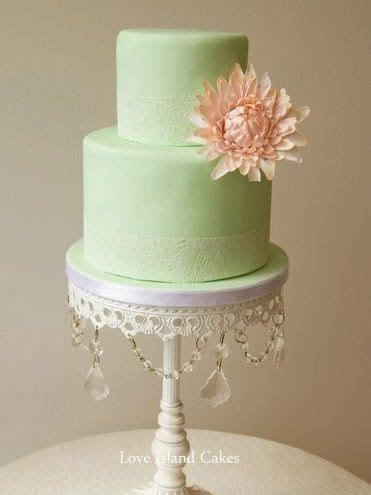 mint green fondant cake with lace band and pink sugar