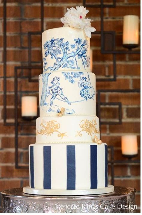 Hand painted blue and gold French toile wedding cake
