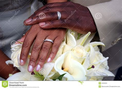 picture with black couples hands with wedding rings on a