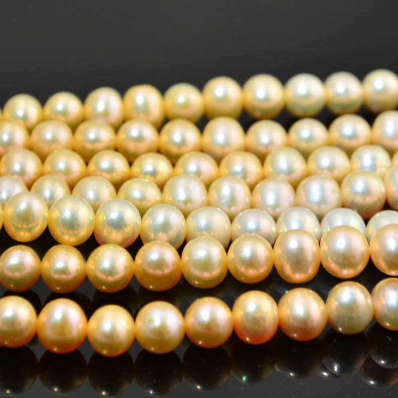 s10860 Freshwater Pearls - 8 x 7 mm Off Round Pearl - Peach (strand)