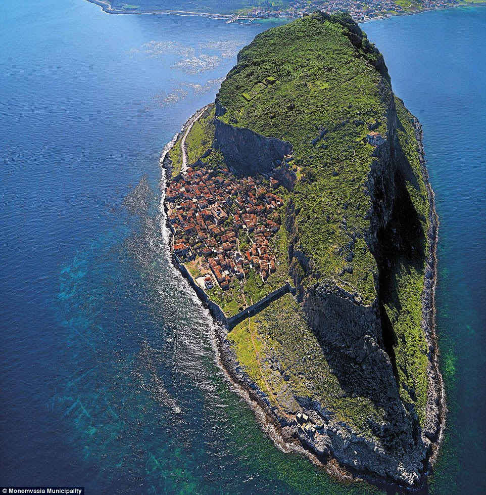 Hidden behind a rock! This tiny settlement is concealed from the Greek coastline behind a giant rock on the island