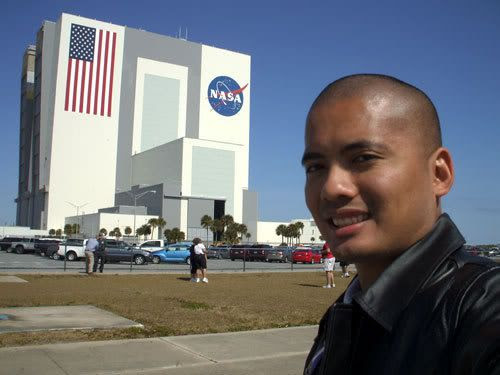 Posing in front of the Vehicle Assembly Building at Kennedy Space Center.
