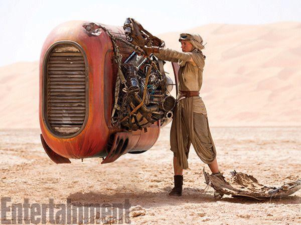 Rey tends to her landspeeder on the planet Jakku in STAR WARS: THE FORCE AWAKENS.