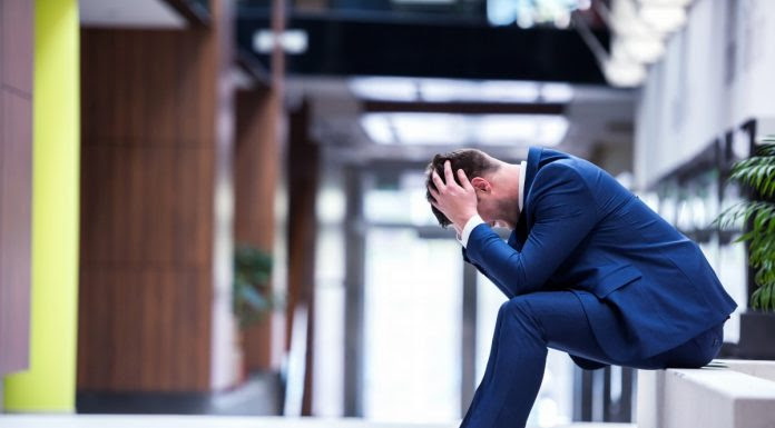 bigstock-frustrated-young-business-man-82577891-696x385