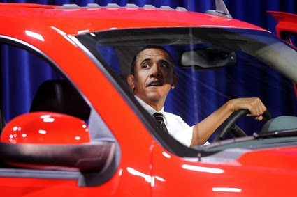 President Barack Obama looks at a Chevrelot Silverado during a visit to the DC Auto Show at the Convention Center, Jan. 31, 2012 in Washington, DC. Obama touted his bailout of General Motors and Chrysler three years ago.