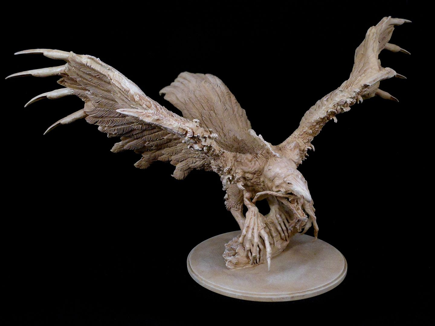 The phoenix from Kingdom Death: Monster, with drybrushing to bring out detail.