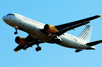 Airbus A320 of Vueling Airlines above Lisbon, ...