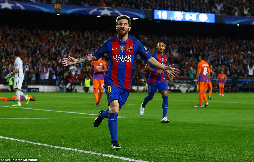 Lionel Messi wheels away in celebration after netting for Barcelona against Manchester City in the first half