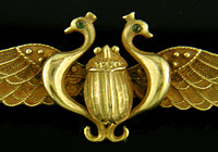 Egyptian Revival winged scarab brooch crafted in 14kt gold. (J3573)