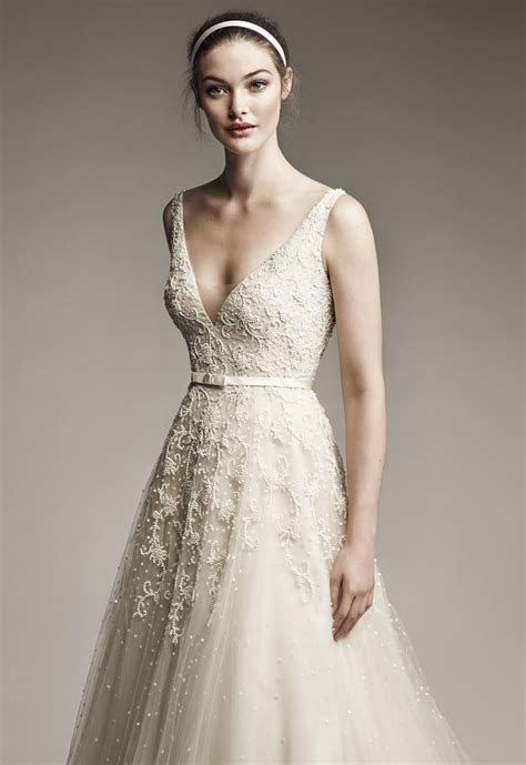 The White Dress by the shore Bridal Gowns