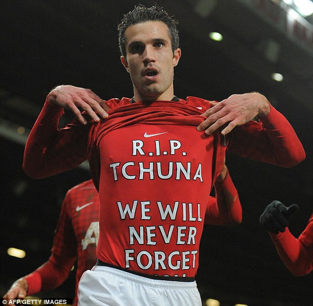 Who is it? Van Persie lifting his club shirt to reveal a message which has sent the rumour mill into overdrive