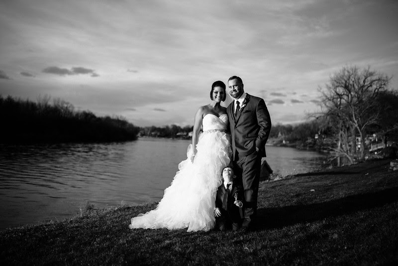 Gorgeous family photos on the Rock River at sunset and romantic couple's portraits after their ceremony at Riverside Community Church for a November Wedding in Rockford IL.